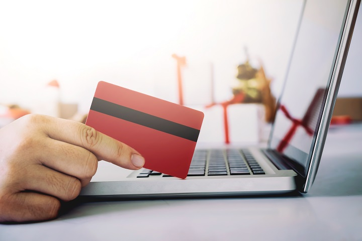 Woman holding credit card and shopping online. New year, Christmas gift shopping.